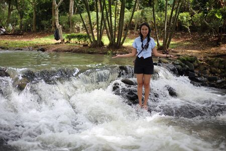 Woman and Nam Tum waterfall in Chanthaburi at thailand