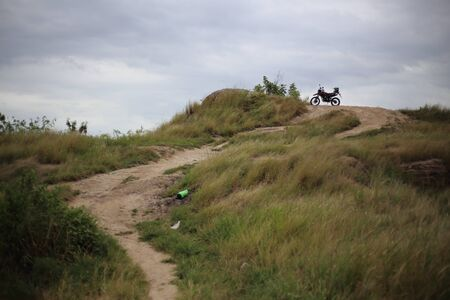 Motocross motorcycle parked on a hill