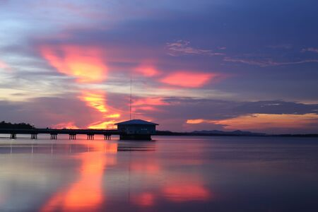 Dokkrai Reservoir and view sunset water reflection at rayong, thailand
