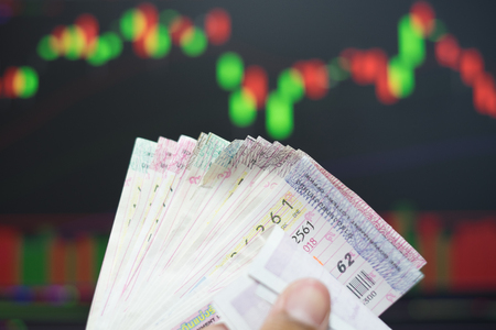 Close up Thai lottery tickets with business background