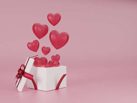 White gift box with red heart float on pink