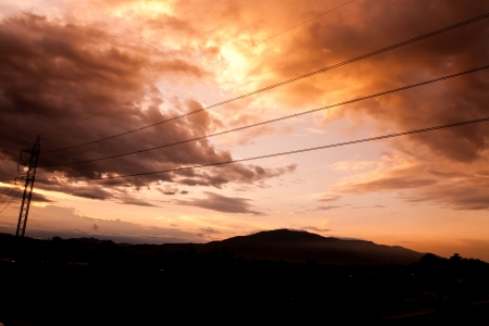 metal pole:  Silhouettes of the power lines