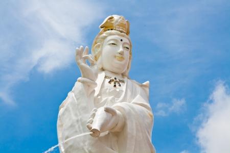 Kuan Yin image of buddha Chinese art on blue sky