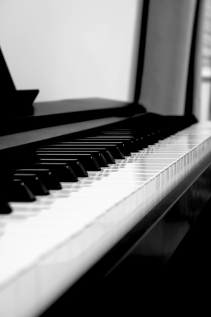 Piano keys side view with black and white photo