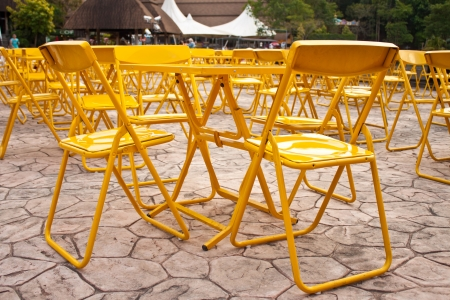 yellow tables and chairs outdoor place photo