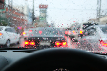 Driving on a rainy in a city, view from inside. Reklamní fotografie