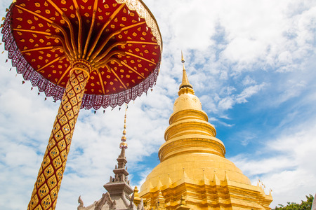 Golden Pagoda at Wat Phra That Hariphunchai in Lamphun province photo