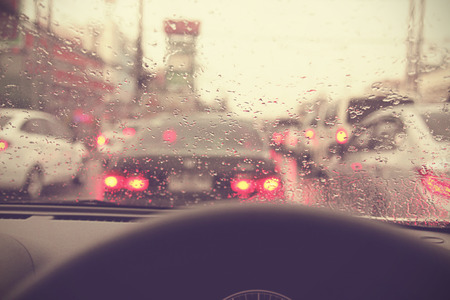 Driving on a rainy in a city, view from inside - Vintage effect style pictures