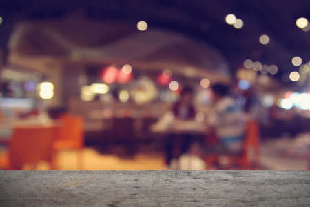 bar top: Empty wood table top with restaurant blur with bokeh background Stock Photo