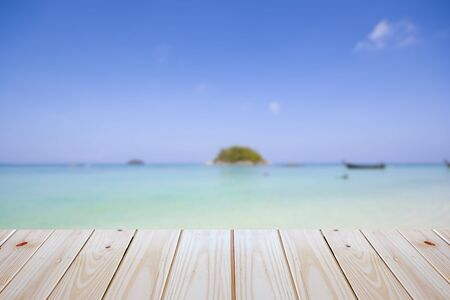empty plywood and blur beach background can be used for product display template