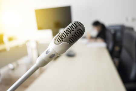 closeup microphone and blur people in conference room
