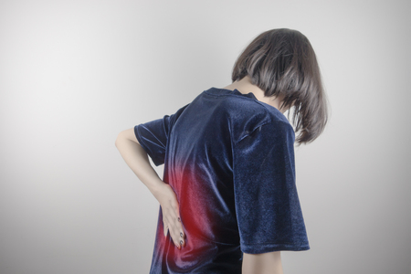 woman suffering from back pain, spinal injury, muscle issue problem Stok Fotoğraf