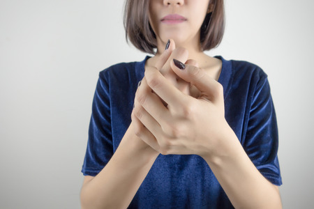 woman touching her injured hand Stok Fotoğraf - 82341272