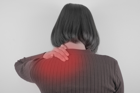 Woman with shoulder pain. Healthcare, Medical and sickness concept