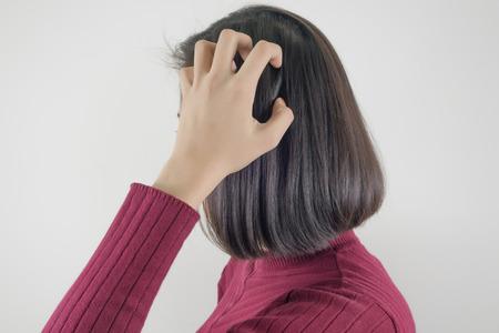 Woman scratching her head Stok Fotoğraf - 82400682