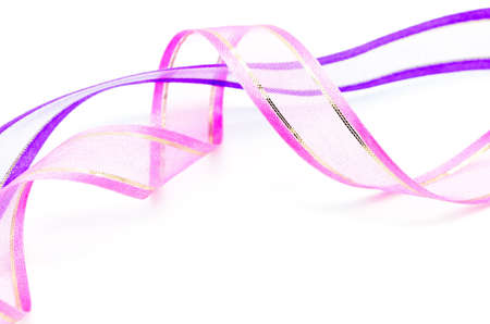 Beautiful pink and purple gift ribbon on a white background  photo