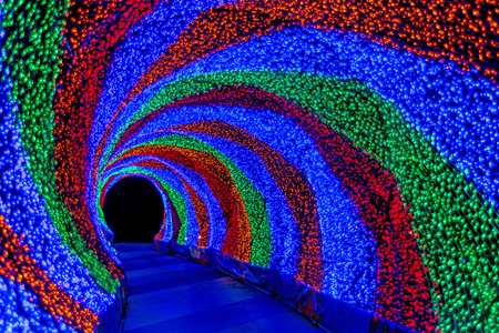 tunnel light: Colorful rainbow tunnel light, abstract background in night Stock Photo