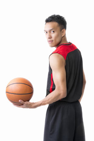 gym ball: Asian young basketball player on white background