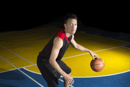 red ball: Asian young basketball player on basketball court