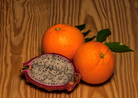 pitaya: Orange and pitaya on wood
