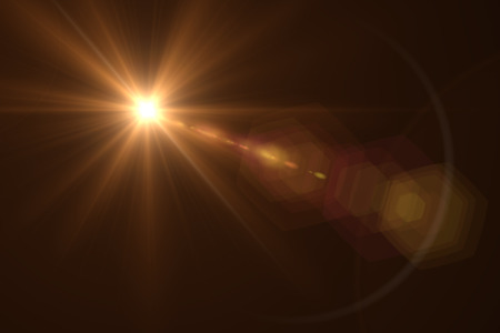 sun flare: digital lens flare in black background horizontal frame warm Stock Photo