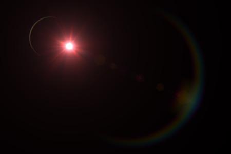 star bright: reflejo en la lente digital en fondo negro marco horizontal caliente Foto de archivo