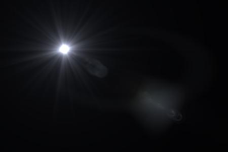 black beauty: digital lens flare in black background horizontal frame warm Stock Photo