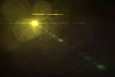 shiny background: digital lens flare in black background horizontal frame warm Stock Photo
