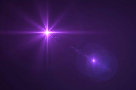 black star: digital lens flare in black background horizontal frame warm Stock Photo