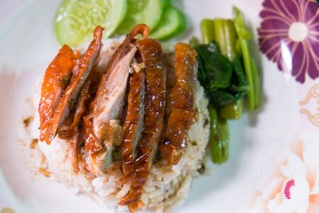 thai ethnicity: Peking duck or Roasted duck  served with steamed rice, Thai food