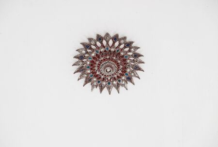 speculative: Ancient colorful carving metal of Ceiling lights in Thailand