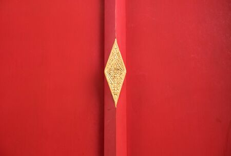Red wooden door with texture and scratch at Wat Pho in Bangkok, Thailand Stock Photo
