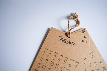 personal perspective: Vintage calendar 2017 handmade hang on white wall, Happy New Year 2017 Stock Photo