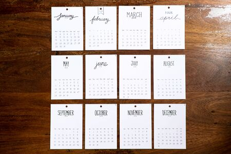 Vintage calendar 2018 handmade on wooden wall, 12 months of the year 2018