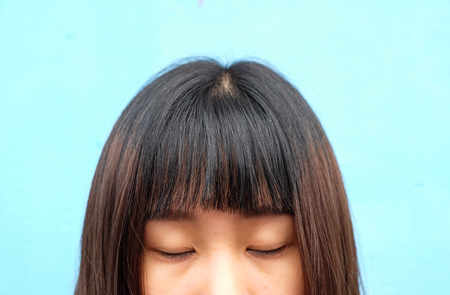 Half face of asian girl who close her eye with bangs hair
