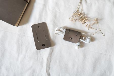 Gray earphone holder on white background