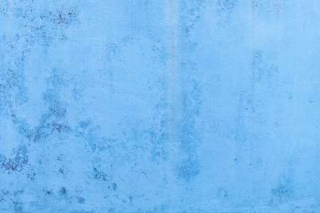 Blue concrete wall with water marks running down
