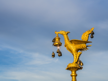 Golden swan lamp and wind bell in temple wat-hong-tong thailand photo