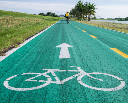 Old bike track , bicycle symbol and biker.