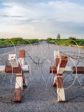 Barbed wire fence block the way photo