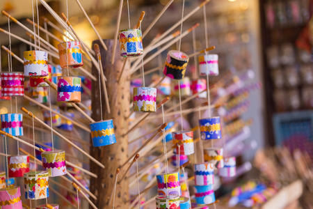 cicada bug: This thai retro toy calling \\\ Jak ka jan \\\ because when swing it. Sound like a cicada bug. It make from bamboo,clay,galipot, small rope and color paper.