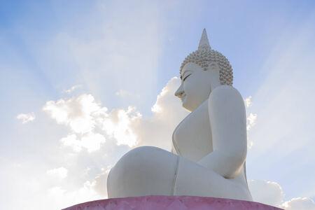 aura sun: White Buddha statue and sun light ray. look like aura from  statue Stock Photo