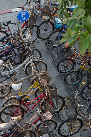 indigence: MINBURI, THAILAND FEBRUARY 06 : More People lock bicycle on rack. In Bicycle Parking  near Main Street  on February 06, 2015 in Minburi,Thailand