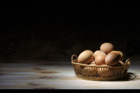 Still life eggs in the basket  in hard light.