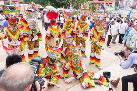 interpretations: Thailand June 26: Photographer shoot Phi ta khon. In Phitakhon masks and dance to show festival on june 26 ,2015 in loei province of thailand