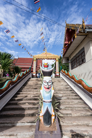 phon: LOEI ,THAILAND-JUNE 26:Stair Ascent to Wat Phon Chai, the important Buddhist temple ceremony of ghost Phi Ta Khon.  masks and dance to show festival in Thailand, at Loei province, on June 26,2014 Editorial