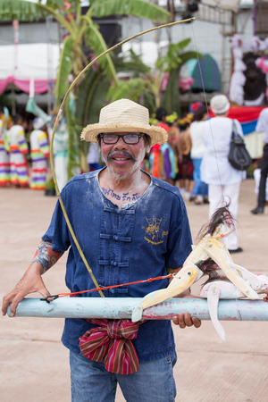 interpretations: Thailand June 26: Man play burlesque love-making toy in Phitakhon festival  on june 26 ,2015 in loei province of thailand