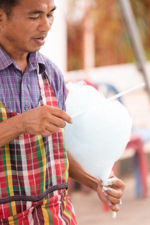 soft sell: Thailand June 26: Man  makeing heart shape candyfloss  in Phitakhon festival  on june 26 ,2015 in loei province of thailand