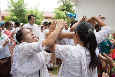 show folk: Thailand June 27:Group people folk dance in Phitakhon masks and dance to show festival on june 27 ,2015 in loei province of thailand