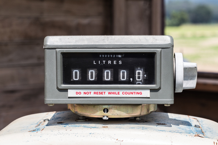 gallons: Old gas pump counter zero sale concept for fuel and energy.